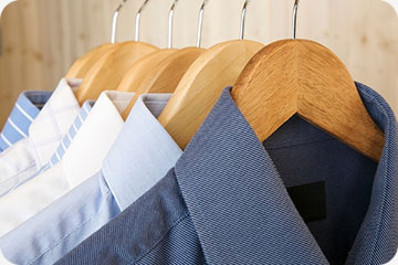 dry cleaned shirts on hangers