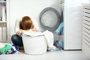 tired woman stressed about laundry